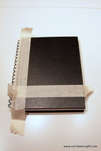 Journal cover with masking tape pattern.