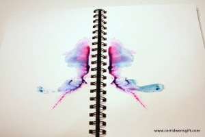 """Facing pages with """"inkblot""""."""