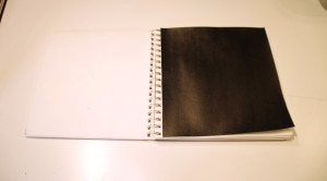 Journal page painted black.