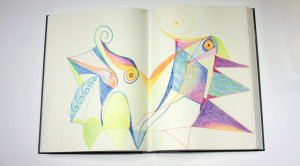 Crayon lines, colors and shapes on two facing journal pages.