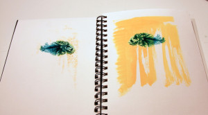 """Blue and green """"jungle"""" mask with underwater scene and fish on facing page."""