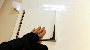 Gluing the page to the cover.