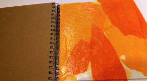 Gluing more tissue paper.