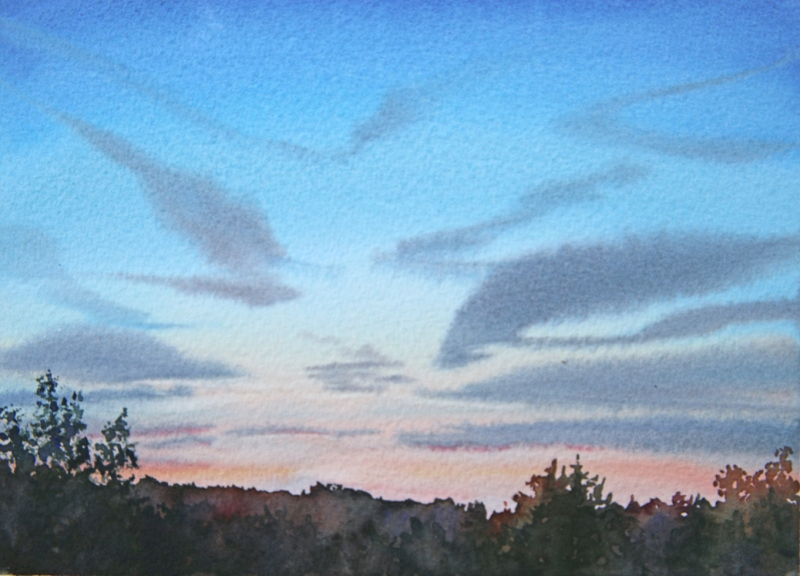 Sunset sky with jet contrails.